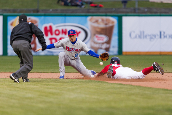 Andy Burns tries tagging out Justin Maxwell stealing second base